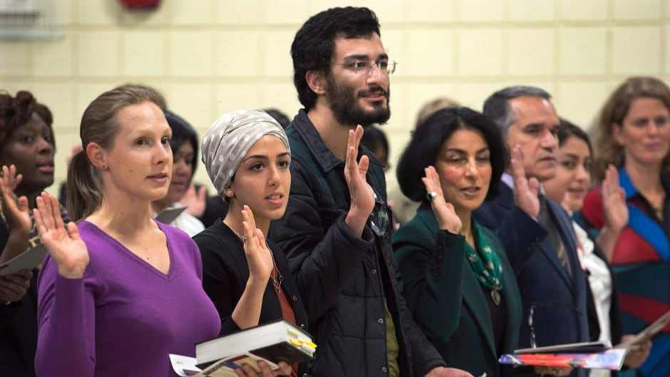 New Canadians take the oath of citizenship at a ceremony in Dartmouth. The dramatic drop in citizenship rates noted as Canada changes citizenship test has some wondering if its unintended consequence or foreseeable fallout?