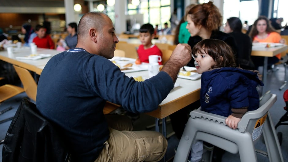 A Syrian refugee family eats at the 'Friedland' refugee camp in the central German village of Friedland.