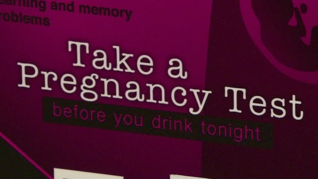 A sign on a pregnancy test dispenser placed in a women's washroom in Yukon as part of a 2015 study. Some MLAs in the N.W.T. would like to see the territorial government study FASD in the North.