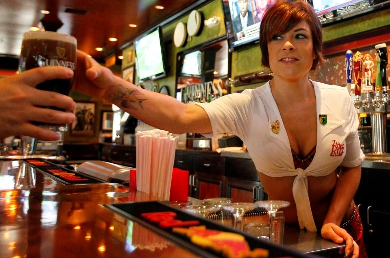 691dca2fd494a Human rights experts say bar and restaurant dress codes requiring female  employees to wear revealing attire could be a potential discrimination  issue