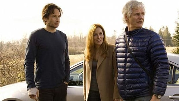 Duchovny, Anderson, and director Chris Carter stand together during the filming of The X-Files: I Want to Believe, which was shot in British Columbia. They will be returning for a new six-episode series.