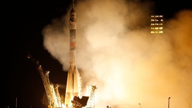 The Soyuz-FG rocket, carrying a new crew to the International Space Station, blasts off at the Russian-leased Baikonur cosmodrome in Kazakhstan, on Friday, March 28, 2015. The Russian rocket was carrying U.S. astronaut Scott Kelly, Russian cosmonauts Gennady Padalka, and Mikhail Korniyenko.