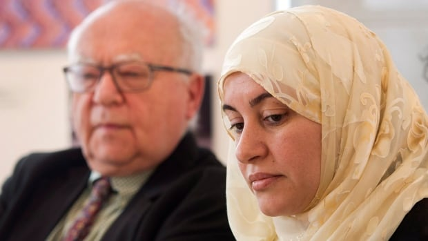 Rania El-Alloul speaks to the media as her lawyer, Julius Grey, looks on at a news conference Friday, March 27 in Montreal.