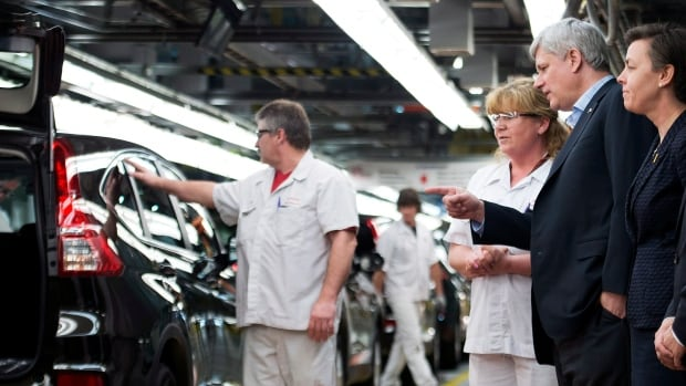 Prime Minister Stephen Harper and Labour Minister Kellie Leitch, right, talk with workers at Honda's manufacturing plant in Alliston, Ont., in March. An internal Industry Canada report suggests Ontario and Quebec have permanently lost manufacturing jobs and that investment is sluggish.