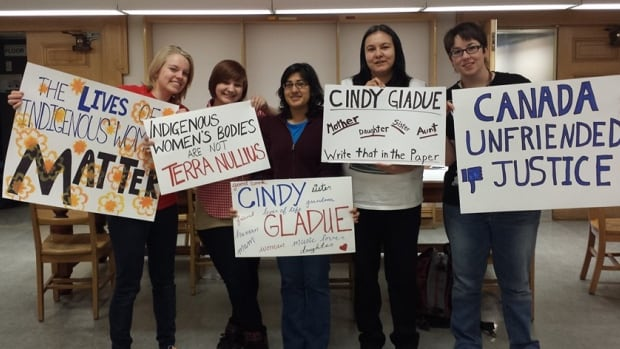 Women in Edmonton make signs for 2015 rally supporting an appeal in the murder trial of Cindy Gladue.