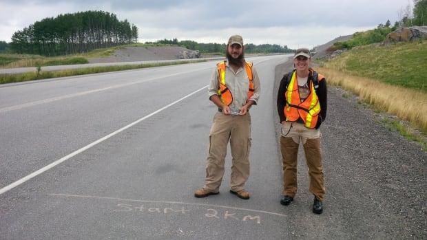 Laurentian University biology students James Baxter-Gilbert and Julia Riley at the the start of their daily walk along Highway 69 in search of reptiles and insects on the road.