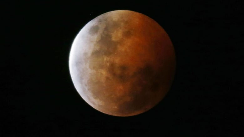 Shortest lunar eclipse in a century shows 'blood moon'