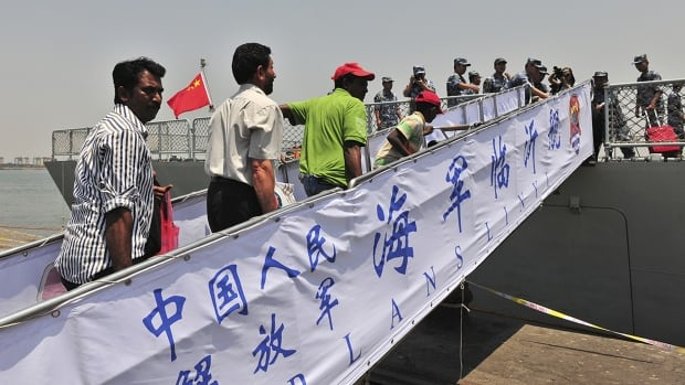 Non-Chinese citizens board a Chinese navy ship during an evacuation from Aden on Thursday China has said it helped 10 countries evacuate 225 of their citizens from Yemen, where Iran-allied rebels have seized the two main cities.