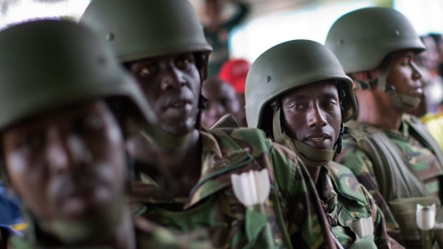 Kenya Defence Forces (KDF) soldiers arrive at a hospital to escort the bodies of the attackers of a school as they were put on public view in Garissa on Saturday.  The KDF said it bombed al-Shabaab camps in Somalia in retaliation for the attack.