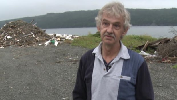 Don Dunphy, seen speaking with CBC News during a 2011 interview, was shot to death in his home on April 5.