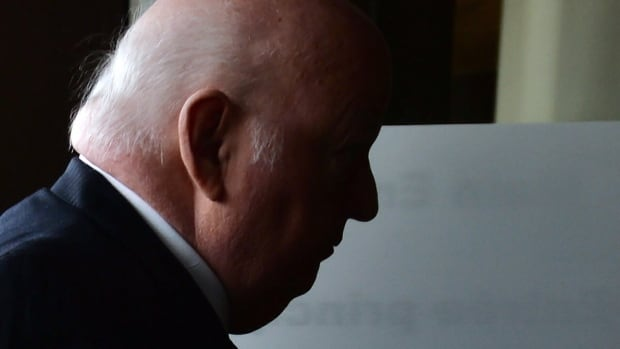 Suspended senator Mike Duffy arrives at the courthouse for the second day of his trial in Ottawa Wednesday. Evidence submitted Tuesday by the Crown included Duffy's declaration of residence.