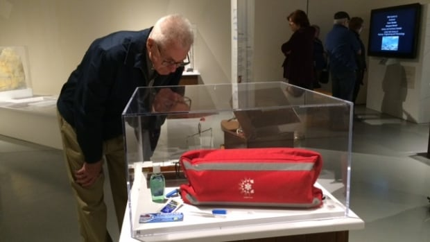 A visitor to this morning's sneak preview of the exhibit, Echoes in the Ice - Finding Franklin's Ship, examines display of artifacts.