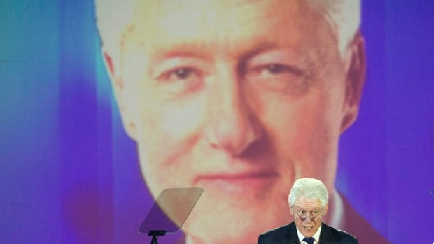 Bill Clinton speaks after receiving an award at the King Center in Atlanta in January. The former president says he will play a minimal role in the early stages of his wife's campaign for the Democratic nomination.
