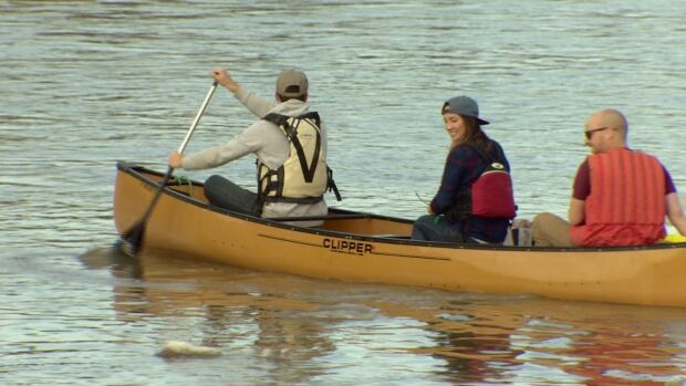 Boaters take to the North Saskatchewan River Friday. On Thursday witnesses reported a sheen of fuel two kilometres long on the river.