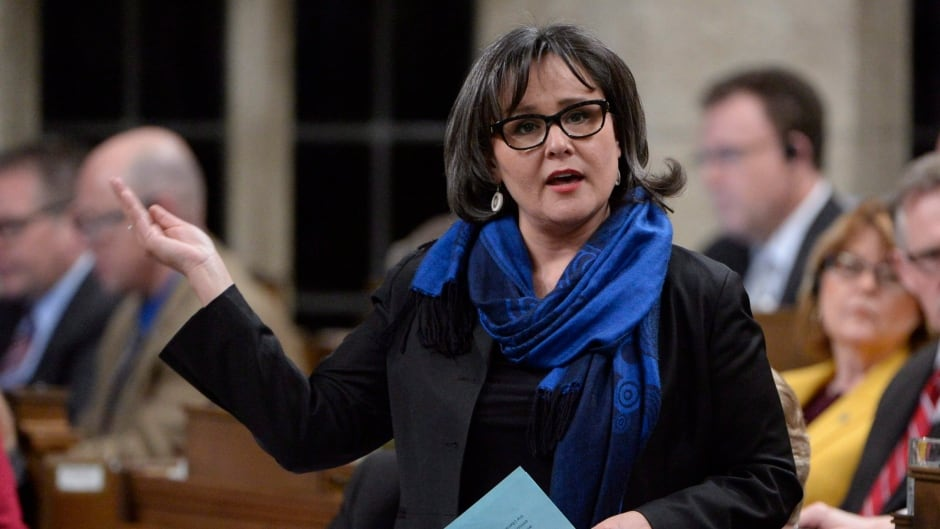 Environment Minister Leona Aglukkaq answers a question during Question Period .