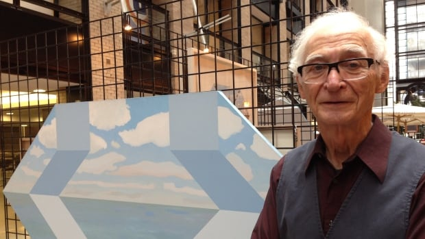 Russell is pictured with his hexagonal canvas, Folding Sea Space, 1976. Some of his work is displayed at the World Trade Centre through April 15.