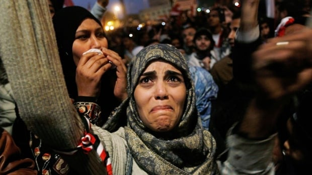 CAIRO, EGYPT - A woman cries in Tahrir Square after it is announced that Egyptian President Hosni Mubarak was giving up power February 11, 2011.