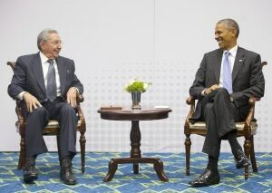 Barack Obama talks with Raul Castro