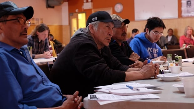 Isadore Manuel of Fort Good Hope, N.W.T., speaks at a meeting on the territory's draft fracking regulations Monday night. 'We are not ready; things are being rushed,' he said.