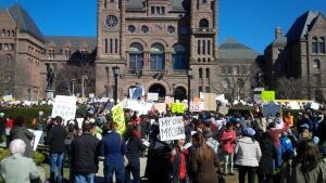 Protesters gather on front lawn of Queen's Park