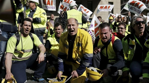 Miners from a gold mine in northern Greece hit their helmets on the ground during a protest outside the Ministry of Development in Athens in support of an investment by Canadian Eldorado Gold corporation.