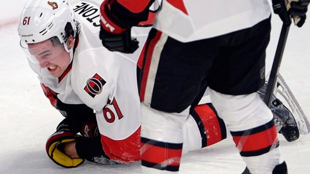 The Senators' Mark Stone grimaces in pain in Wednesday's Stanley Cup playoff opener against Montreal. The rookie forward was slashed by Montreal defenceman P.K. Subban in the second period but stayed in the game. The Senators tweeted Thursday that Stone has a fractured right wrist.
