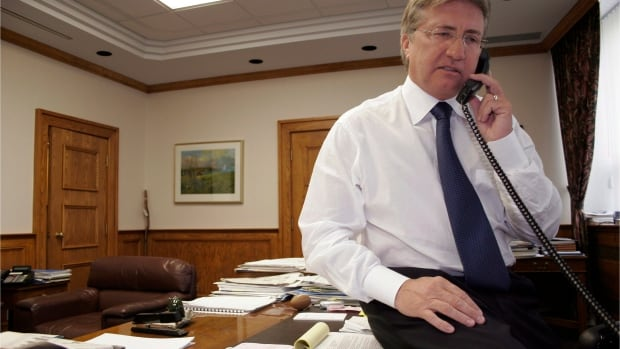 """Danny Williams talks on the phone in his office in St. John's in this undated handout photo. The new documentary film """"Danny"""" is more than a showcase of the life and fights of Newfoundland and Labrador's still hugely popular former premier, Danny Williams."""