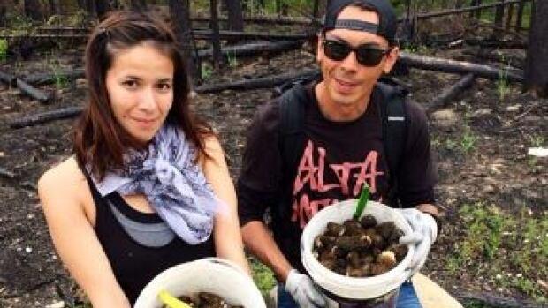 Jessica Minoza and friend, Riel Stevenson Burke pick morel mushrooms.