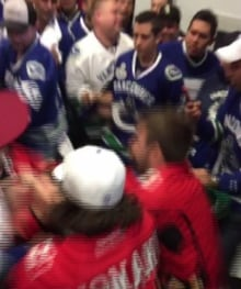 Calgary Flames fans and Vancouver Canucks fan brawl at Rogers Arena