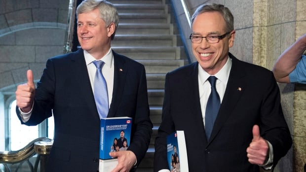 Prime Minister Stephen Harper, left, stands with Finance Minister Joe Oliver as he arrives to table the budget on Parliament Hill in Ottawa on Tuesday.