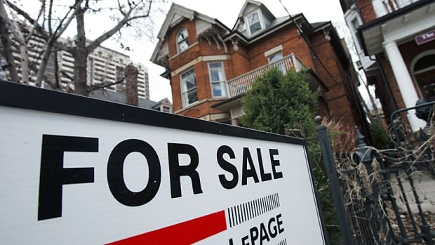 A home is listed for sale in Toronto's hot real-estate market. The Economist magazine published a recent analysis saying Canada's housing prices are 35 per cent overvalued.