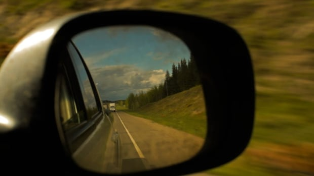 A still from Matt Smiley's documentary, 'Highway of Tears' shows B.C.'s Highway 16 through a rear-view mirror.