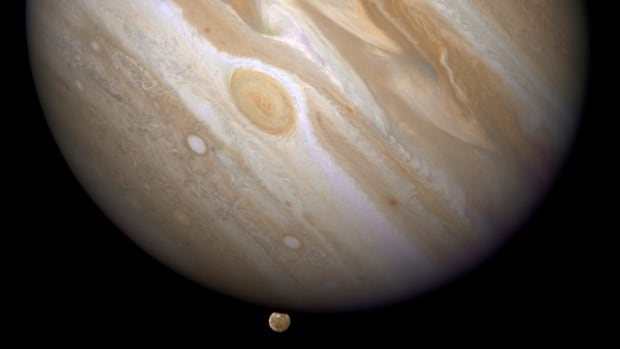 NASA's Juno spacecraft will explore Jupiter's Great Red Spot, an enormous, long-lived storm, on Monday. Ganymede, one of the planet's many moons, hangs below.