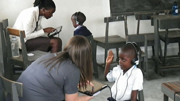 Children are tested at a CanHEAR screening clinic in Kampala, Uganda, last year.