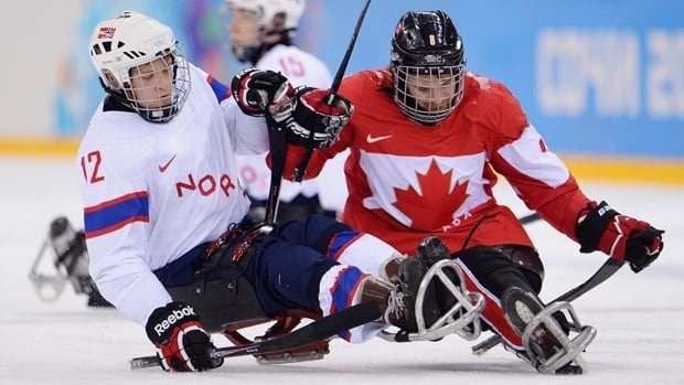 Tyler McGregor, right, seen here in a 2014 Paralympic game against Norway, was in on five of Canada's eight goals on Wednesday in Italy.