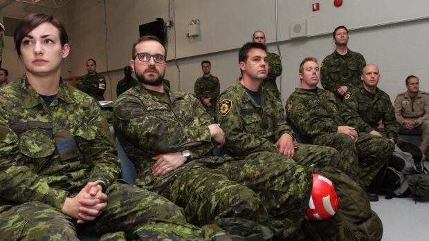 Canadian forces sit in the lounge and wait at CFB Trenton,in Trenton, Ont., on Sunday.  Canada is dispatching advance elements of its highly specialized disaster assistance response team to earthquake-ravaged Nepal. THE CANADIAN PRSS/Lars Hagberg