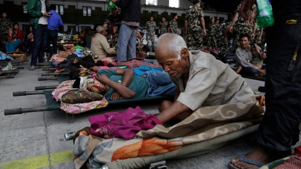 Victims of Saturday's earthquake wait for ambulances at the airport in Kathmandu, Nepal, on April 27, 2015.