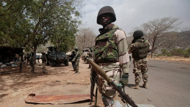 Nigerian Soldiers man a checkpoint in Gwoza, Nigeria, a town newly liberated from Boko Haram. Military operations continue in the area after the rescue of 293 kidnapped women and girls.
