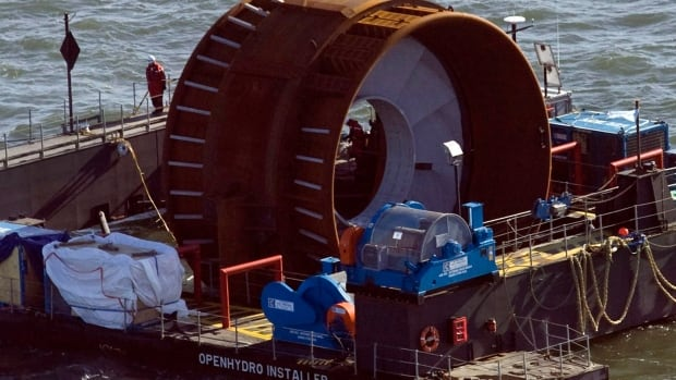 Technicians deploy a commercial tidal turbine in the Bay of Fundy near Parrsboro, N.S. in 2009.