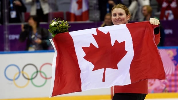 Canada's flagbearer Hayley Wickenheiser following the medals cermony at the Sochi Winter Olympics.