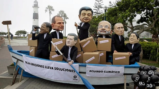 Keep rowing: Environmental activists perform as world leaders at the UN-sponsored climate change conference in Lima, Peru, in December. The next UN conference, in Paris this fall, will set new targets for national emissions reductions.