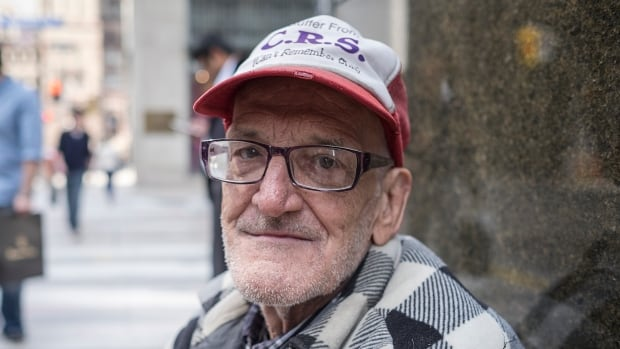 Guy Dheilly, 64, says some people are friendly as he asks for change in Toronto's financial district but says others pretend like he's not even there.