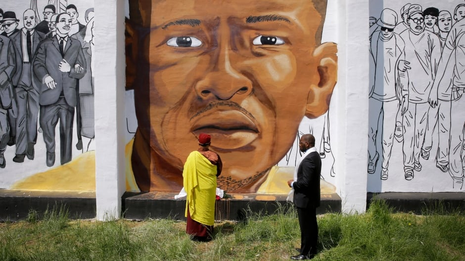 Faith and community leaders in Baltimore view a mural of Freddie Gray on May 7, 2015.