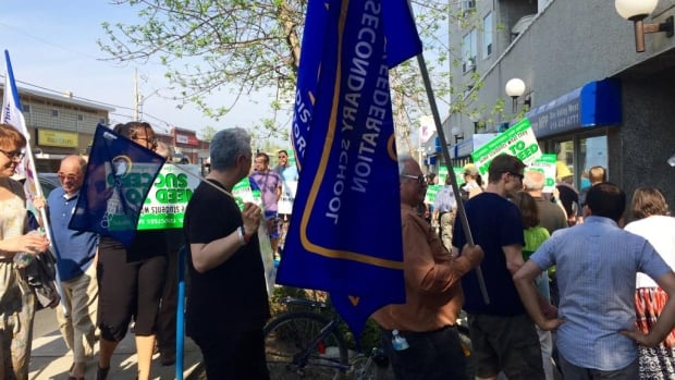 Members of ETFO and other teachers' groups rallied outside the constituency office of Ontario Premier Kathleen Wynne in Toronto in May.