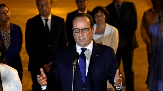 French President Francois Hollande speaks to reporters on the tarmac of Jose Marti Airport in Havana late Sunday night.  Hollande is the first French president to ever visit Cuba.