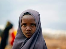 "A Somali refugee child carries her sibling at the Ifo camp in Dadaab near the Kenya-Somalia border, May 8, 2015. Kenya's government threatened to close the Dadaab refugee camp, the world's biggest refugee camp was seen as a security risk. The United Nations refugee agency urged Kenya to reconsider an order to close the teeming Dadaab refugee camp, warning that sending Somali refugees back to their homeland would have ""extreme humanitarian and practical consequences""."