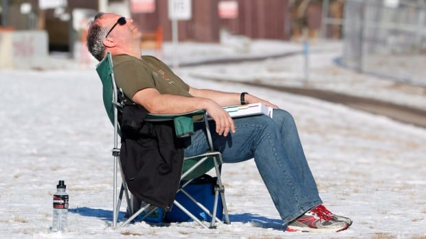 Calgarian Erik van Kuppeveld takes a break from reading and takes in the sunshine and 9C temperatures earlier February. Warm air from the Pacific as a result of El Nino has led to a warmer-than-average late fall and winter in much of Canada.