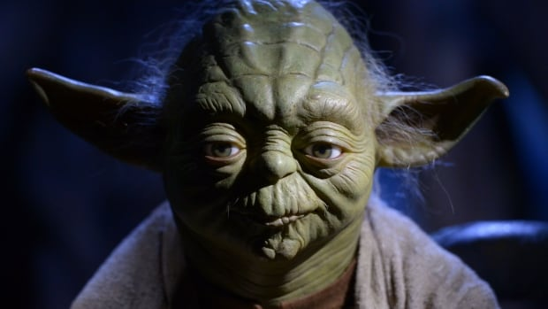 Movie-goers are warned by the CEO of Guzzo Cinemas in Montreal that they won't be able to wear a mask - even one of their favourite film characters, such as Yoda seen here - if they attend a screening of Star Wars: The Force Awakens.