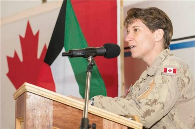 Brigadier General Lise Bourgon speaks at the change of command ceremony in Kuwait today.