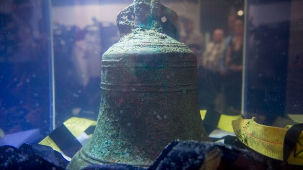 The ship's bell from the Franklin expedition shipwreck HMS Erebus sits in pure water after being recovered in Ottawa Nov. 6, 2014. A new exhibition in London highlights items from the doomed voyage.